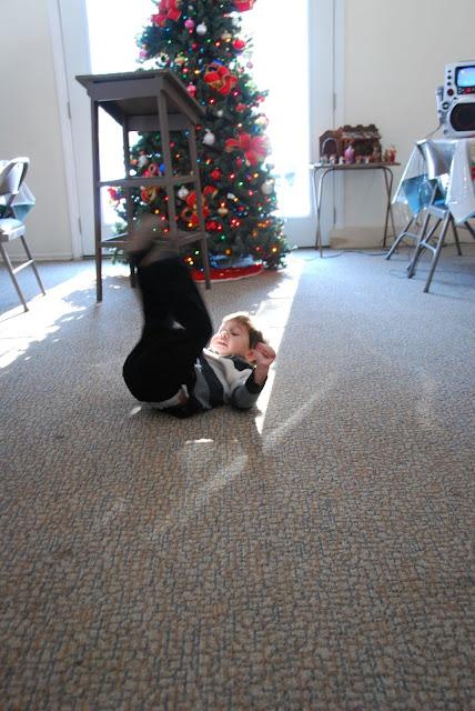 Christopher demonstrates the art of tumbling gymnastics.