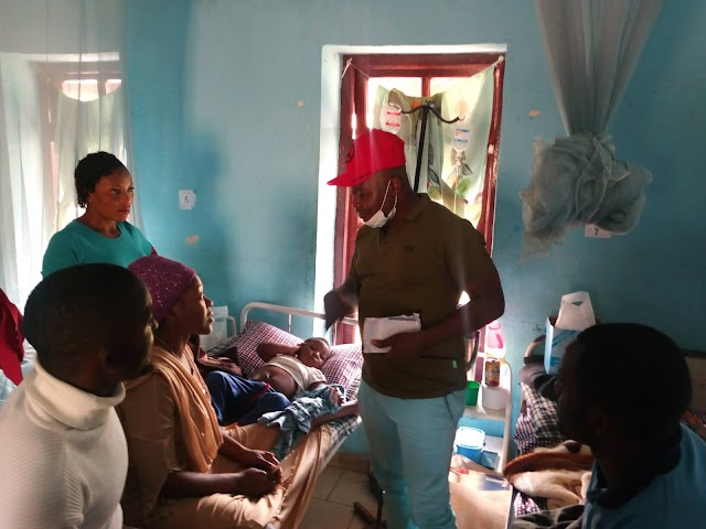 Hon Agho Oliver Fetes with patients at Christmas