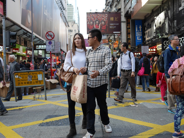 couple with a Muji bag at Sai Yeung Choi Street South