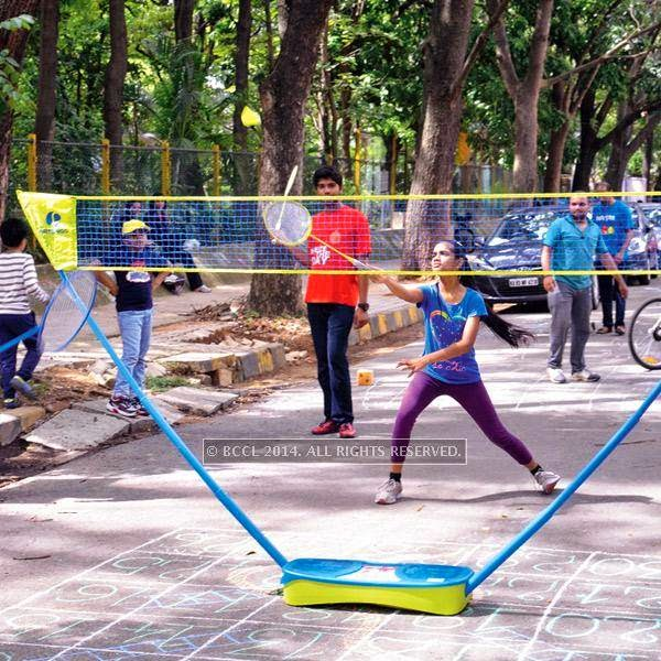 People play during the Cycle Day celebrations, in Bangalore.