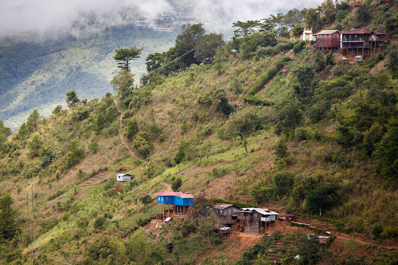 Forested slope of the Chin State with some houses scattered