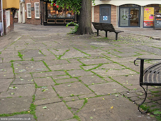 June 2013. Raised area, King's Square. A bit of weeding would have made the place look less neglected?