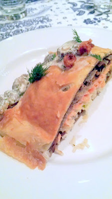 DaNet Third course. Kulybyaka (King Salmon with Sturgeon Cheek Porcini Pie with morel and sour cream dill sauce and viziga cracklings)