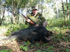 Mr Taylor from UK with a really old boar with some serious tusks, Carmor Plains