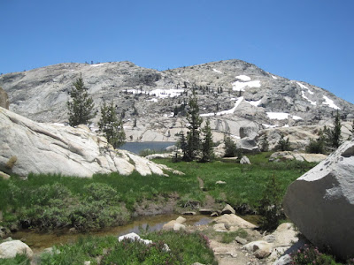 This tiny meadow is right where the trail hits Emigrant Lake.  The meadow entering Emigrant Lake.   We had met a few people who told us the mosquitoes here were the worst they had ever seen .  ©http://backpackthesierra.com