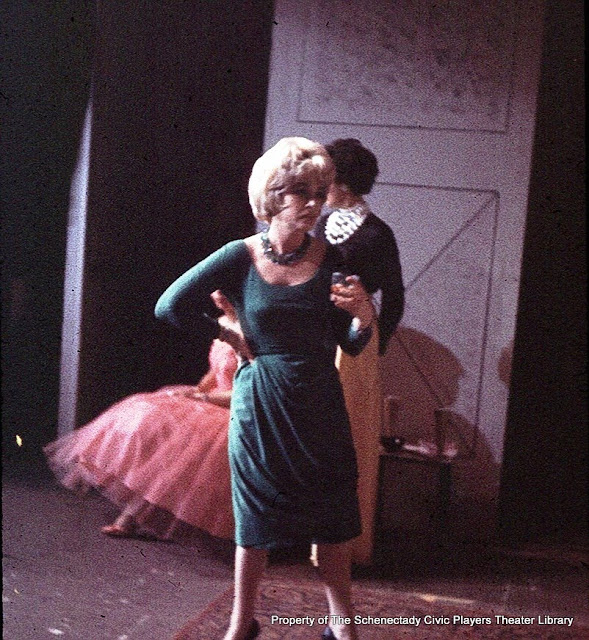 Betsy Morray with Martha Goldhoff in the background in AUNTIE MAME - December 1961.  Property of The Schenectady Civic Players Theater Archive.