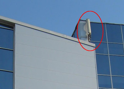 cellphone antenna on a building
