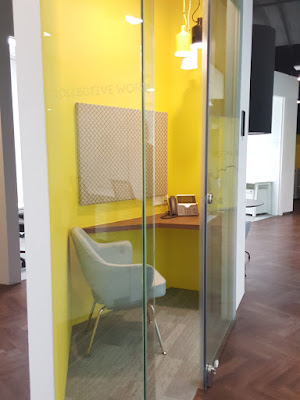 Sound-proof phone booths for conference calls.