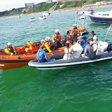 The ILB crew assist a RIB that was taking on water as its bilge pump was not working. An ILB crew member went onboard and unblocked the pump, which enabled it to pump out the water. 1 September 2013 Photo: RNLI/Poole