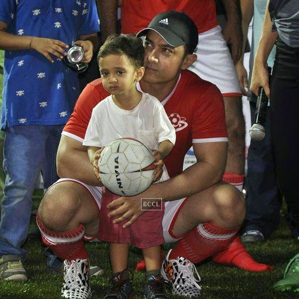 Aamir Khan clicked with his son Azaad during a charity soccer match organised by his daughter Ira Khan, at Cooperage ground, on July 20, 2014.(Pic: Viral Bhayani)