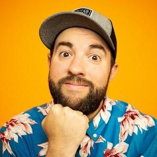 Matt Giovanisci in a Hawaiian shirt on an orange background