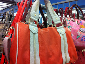 Photo: Have you ever checked out Marshall's purse section? While it can be an overwhelming process, if you take the time to search through them all I promise you'll find the perfect fit! This orange leather bag would definitely comeplete my tailgating outfit.