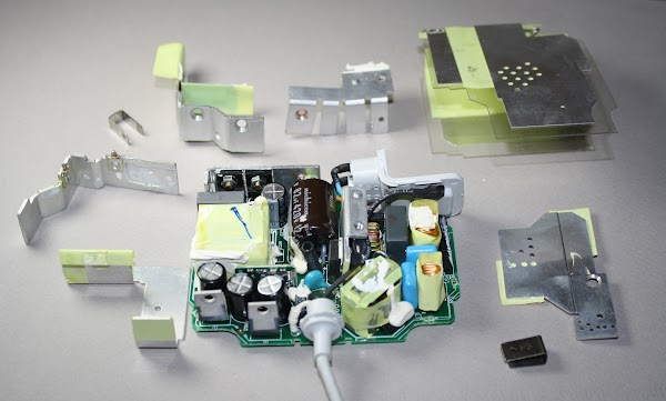 The Circuit Board Inside A Genuine Ipad Charger Showing The Components