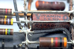 A Vitamin Q capacitor in an IBM 705 tube module.