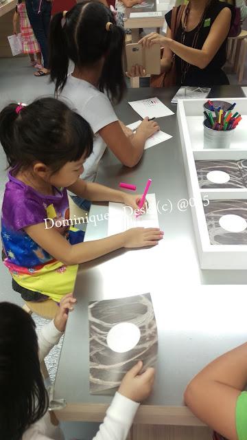 Tiger girl filling up a postcard