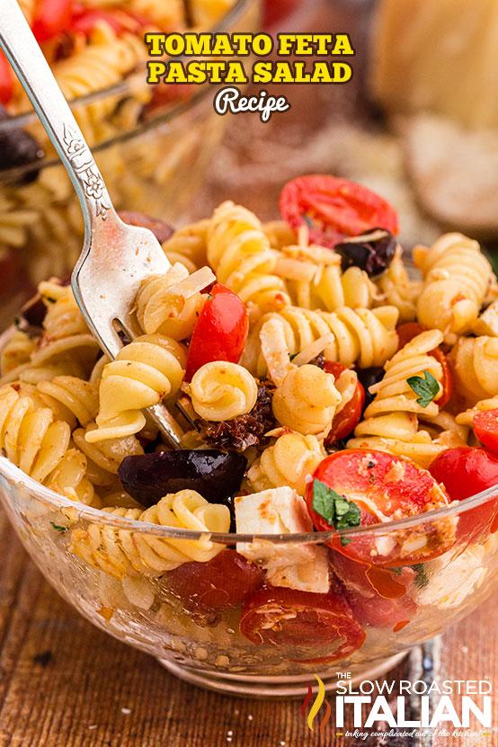 Tomato Feta Pasta Salad in a clear bowl
