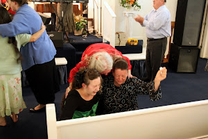 Momma Templet praying in the altar with beautiful souls in Shreveport, LA.