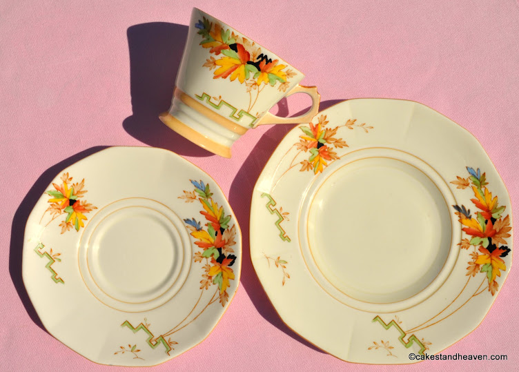 Art Deco hand painted cream china trio with leaves and geometric pattern
