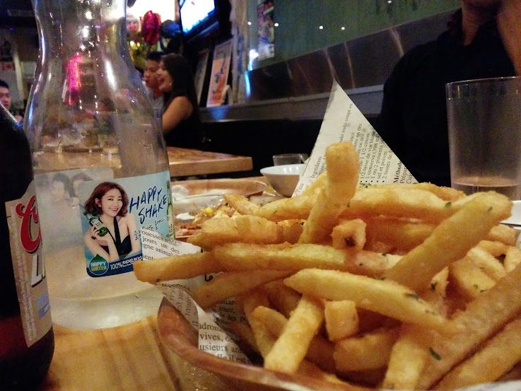 Fries with a party scene at Dakgogi