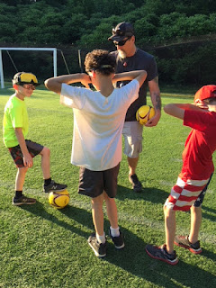 James Howard from DBVI teaching students soccer.