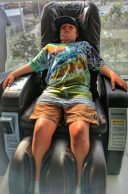 Boy on airport massage chair