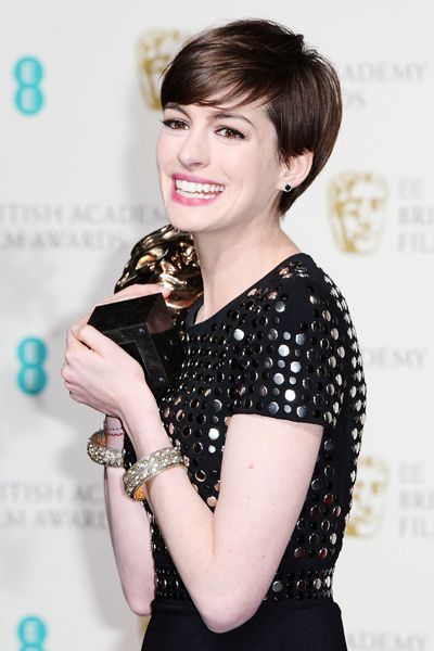 American Actress Anne Hathaway Poses Backstage With The Award For