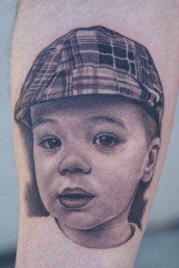 Boy in Plaid Hat