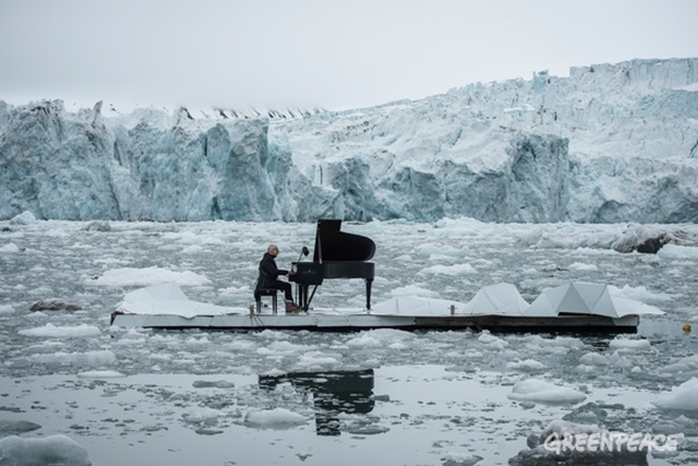 Acclaimed Italian composer and pianist Ludovico Einaudi performs on a floating platform in the Arctic Ocean, 20 June, 2016. Ludovico Einaudi has turned eight million voices into music, 'Elegy for the Arctic', specially composed to help protect the Arctic. As he performed this piece for the first time — in front of a magnificent surging glacier — the music echoed across the ice. Photo: Greenpeace
