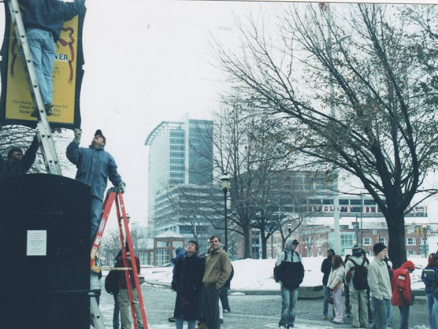 Hanging the sign for the Phoenix Shot Tower
