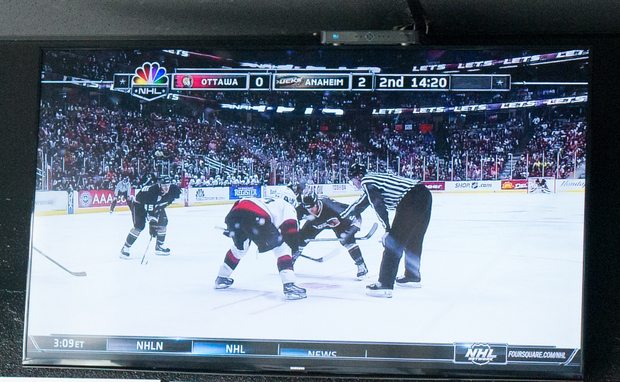 photo of a TV with a hockey game