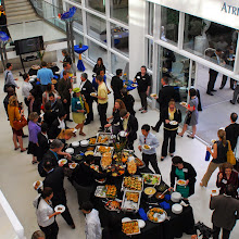 Attendees mingle in the Atrium after the event.