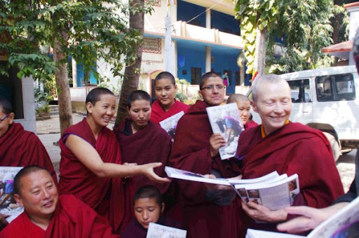 "Ven. Lekshe Tsomo distributes women's health book ""Healthy Bodies, Healthy Minds"" to nuns, Bodhgaya, India, January 2012. Photo by Marlies Bosch."