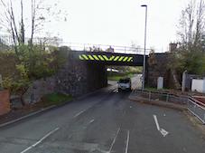 Lorry strikes railway bridge, closing road and rail services