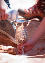 Photo: Miriam's cup: pouring out the precious resource of water, udner Corona Arch.