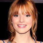 bella-thorne-long-wavy-red-hairstyle-braids-twists-bangs.jpg