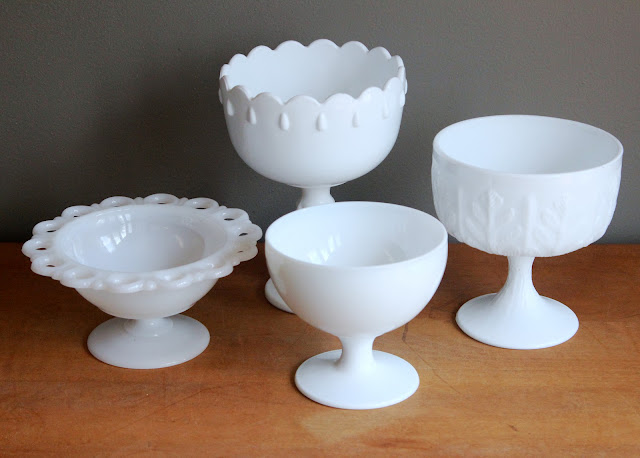 Small milk glass pedestal bowls available for rent from www.momentarilyyours.com, $1.00 each.