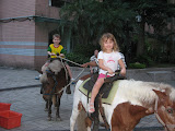 Mollie and Josh on a pony ride in our courtyard during Moon Festival celebrations
