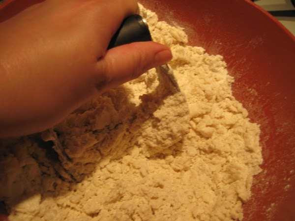 Mix flour and salt.  Using pastry cutter, cut shortening into flour. Once it...