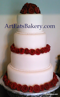 Four tier fondant wedding cake design with edible red sugar rose flowers and pearls