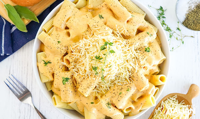 pasta with pumpkin sauce and cheese on top