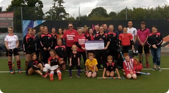 Katie Gibbs-Blythe  from Crewe Vagrants Hockey Club presents the cheque to Liz and Mike Boffey from Bloodwise