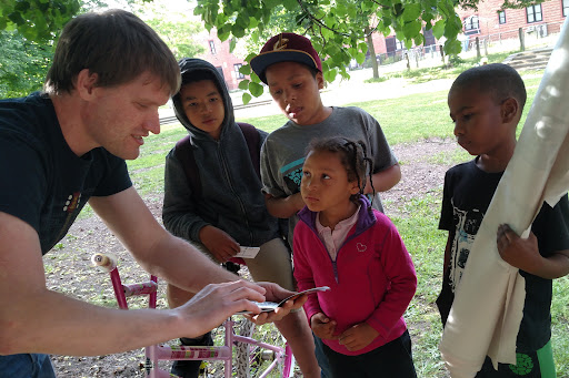 The kids were laser-focused on David when he took them through the kid's gospel booklet.