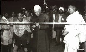 Pandit Nehru cutting the ribbon during inauguration of the library building and auditorium - 23rd Nov 1956