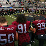 The Griz meet at the 50-yard line for a post-game prayer.