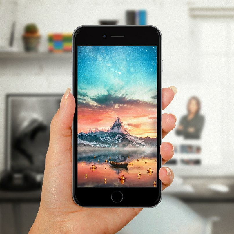 A Mobile Phone In Your Hands With Colourful Wallpapers