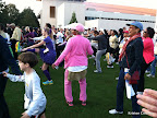The lady in the pink outfit wasn't even trying to follow along. She was just grooving to the tunes and shaking her booty!