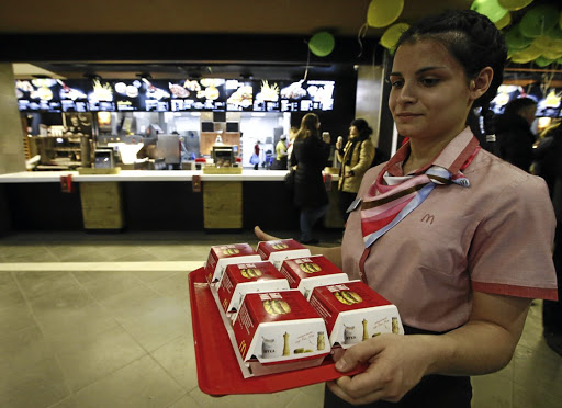 A McDonald's employee holds a tray of Big Mac burgers at a  fast food restaurant in central Moscow, Russia.   Picture: REUTERS