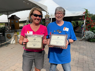 Corcoran Management Company employees posing with their 30 and 35 year plaques at Kimball Farm