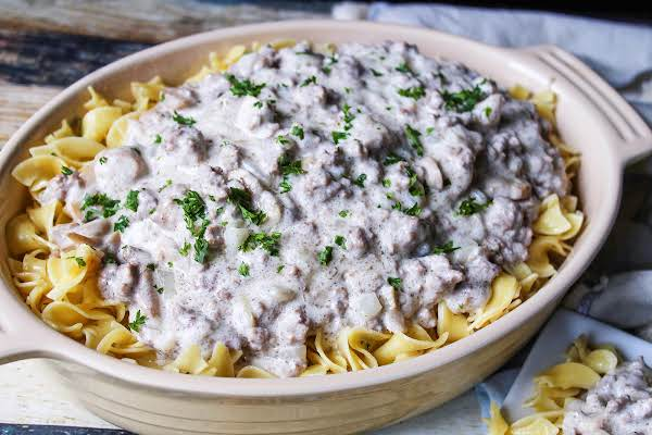 A Bit Dish Of Poor Man's Beef Stroganoff Over Egg Noodles.