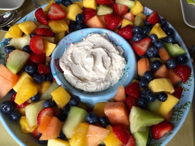 Fresh fruit salad with mango, melon, strawberries and blueberries
